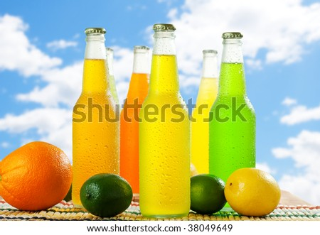 Wet bottles with cold beverage on nice sky - stock photo