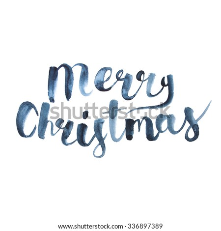 Wet brush watercolor lettering that says Merry Christmas.  - stock photo