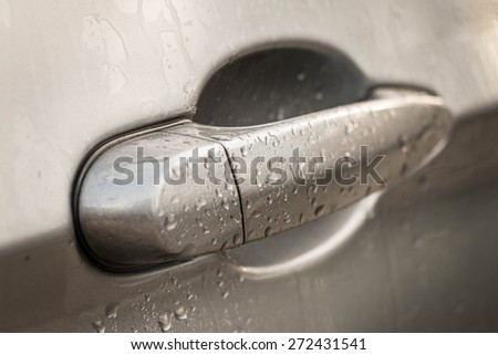 Wet car handle after a wash - stock photo