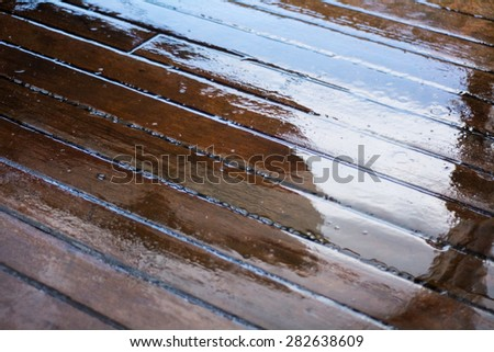 wet deck planks on a sailing yacht, background texture, narrow depth of field