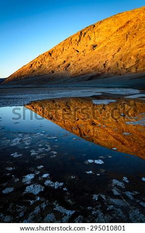 Wet Desert Salt Landscape of Death Valley - stock photo