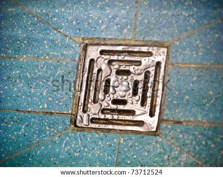 Wet drain in the bathroom - stock photo