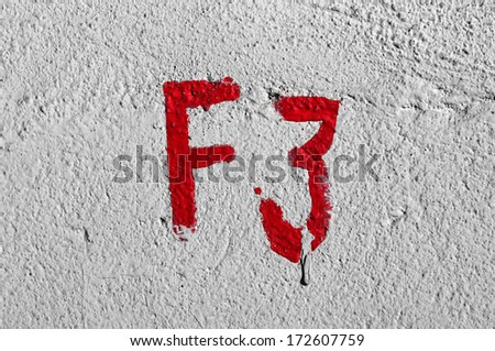 Wet drop painting over red hand wall inscription. - stock photo