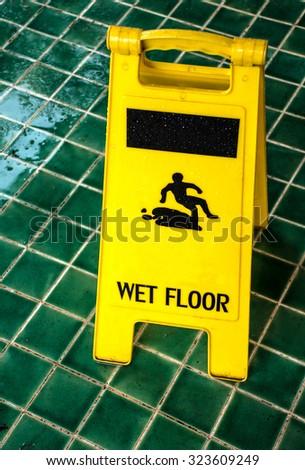 Wet floor caution sign - stock photo