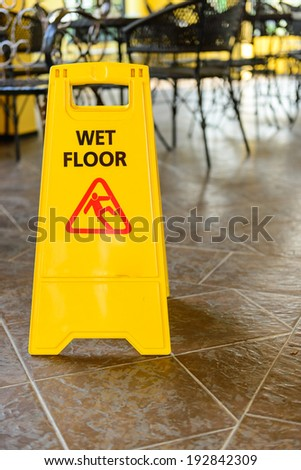 wet floor sign on the floor at the coffee shop,Thailand