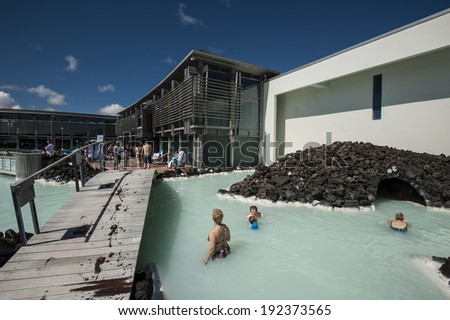 Wet footsteps/Blue lagoon in Iceland is one of the top 10 natural spas in the world. People come from all over the world for skin treatment and relaxation. Blue lagoon, Iceland, June 21, 2012 - stock photo