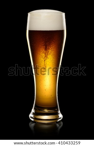 Wet Glass of dark beer isolated on black background. With clipping path