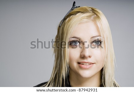 Wet hair customer ready for hairdresser haircut with comb or clip in hair - stock photo