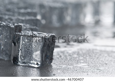 Wet ice cubes objects over water surface