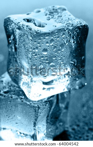 wet ice cubes on black glossy background