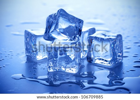 wet ice cubes on blue background - stock photo