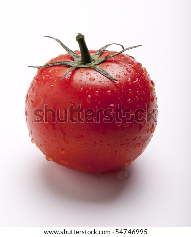 Wet juicy tomato on isolated on white - stock photo