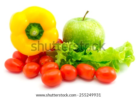 Wet lettuce with the green apple, yellow pepper and many cherry tomatoes isolated on white background. Focus on the green apple - stock photo