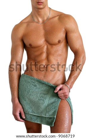 Wet muscular sexy man wrapped in the towel isolated on white - stock photo