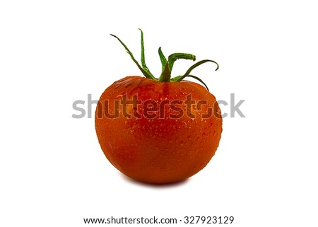 Wet organic ripe vine tomato against white