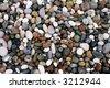 wet pebbles on a beach - stock photo