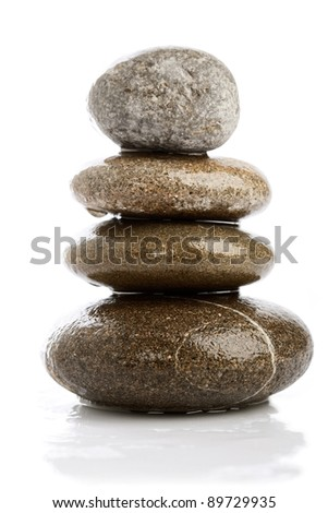 wet pebbles over white backgrounds - stock photo