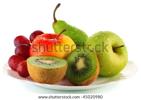 Wet ripe fruits on plate