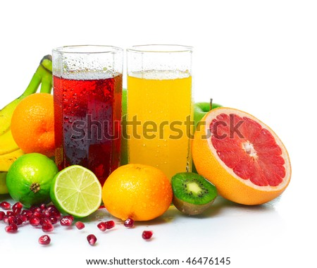 Wet ripe fruits with juice glasses on white background - stock photo