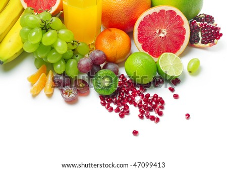 Wet ripe tropical fruits and glass with juice - stock photo
