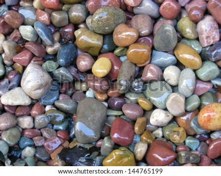 Wet river stones - stock photo