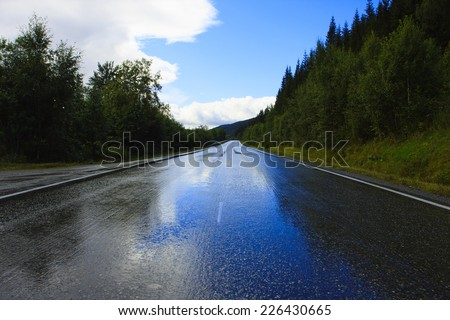 wet road after the rain  - stock photo