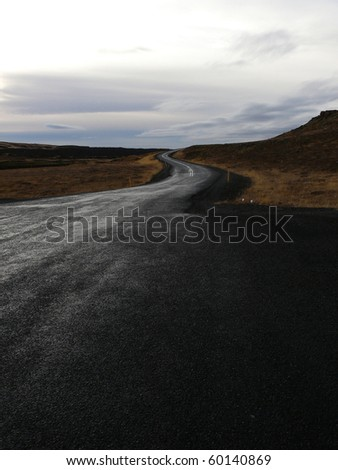 Wet road in Iceland. - stock photo