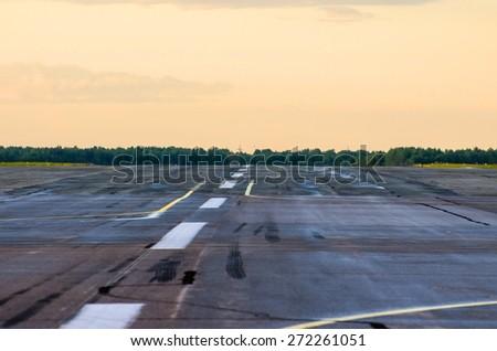 Wet Runway airport airplane strip plane asphalt road line zoom - stock photo