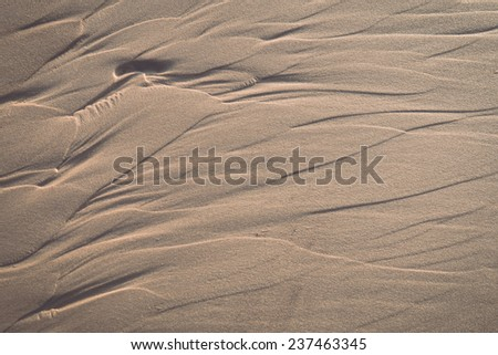 Wet sand texture in the sea shore beach - retro, vintage style look - stock photo