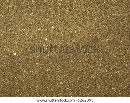 wet sand texture on the sea - stock photo