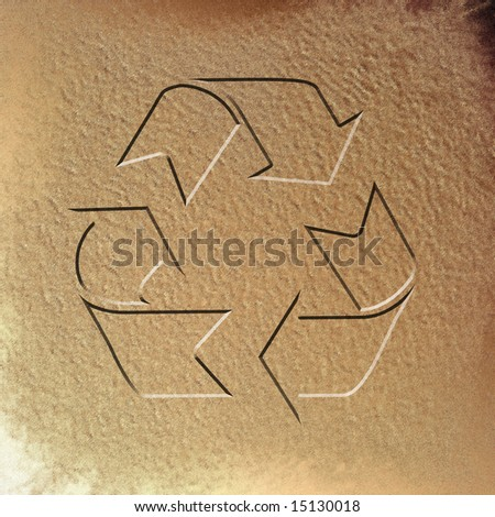 wet sand with the recycle symbol in it