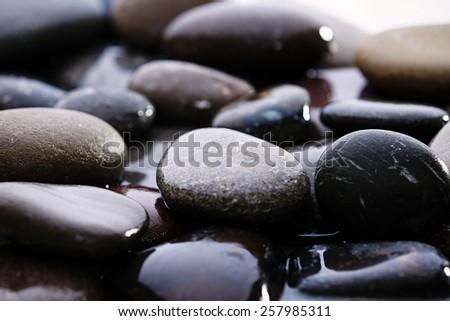 Wet sea pebbles, macro view - stock photo