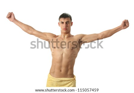 Wet sexy man wrapped in a yellow towel isolated on white - stock photo