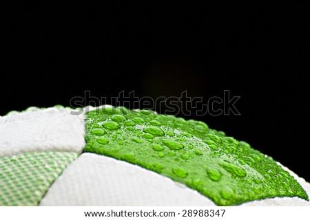 Wet soccer ball closeup - stock photo