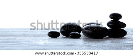 Wet spa stones isolated on white - stock photo