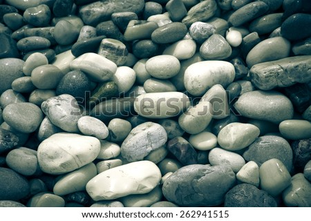 wet stones pebble beach. - stock photo