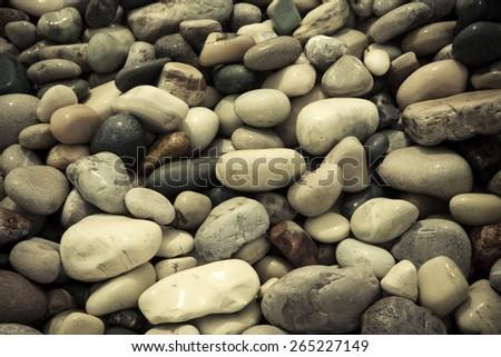 wet stones pebble beach. - stock photo
