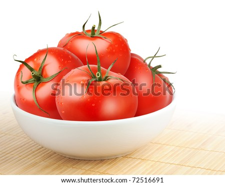 Wet tomatoes in a bowl isolated on white - stock photo