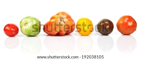 wet tomatoes in a row isolated over white - stock photo