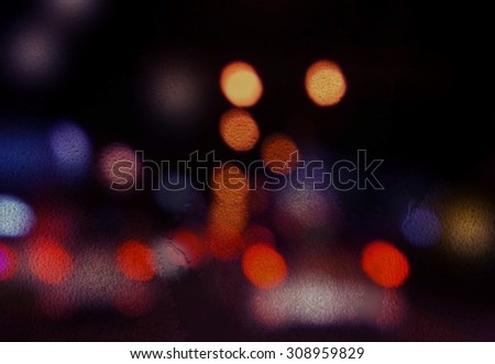 Wet window with the background of the night city - stock photo