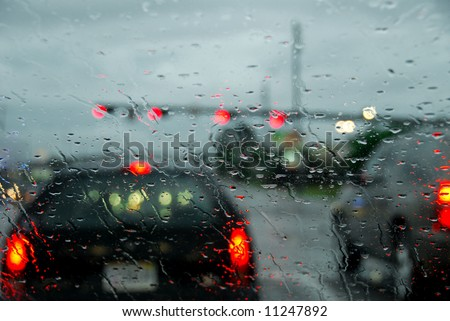 Wet windshield and blurred traffic during rain storm - stock photo