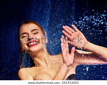 Wet woman face with water drop. Moisturizing. - stock photo