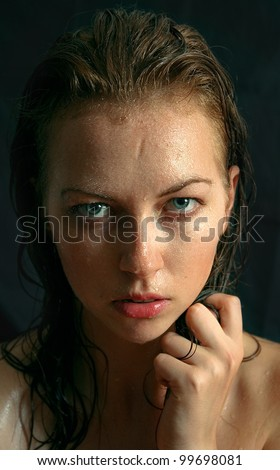 Wet woman portrait with water drops on the face - stock photo