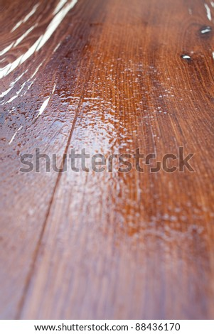 wet wooden surface with oil or varnish/wet wooden surface - stock photo