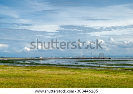 Wetlands and salt marshes of the Waddensea and the harbour of West-Frisian island Schiermonnikoog, Netherlands - stock photo