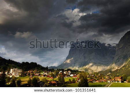 Wetterhorn Peak (3692m) and Grindelwald Village, Berner Oberland, Switzerland - UNESCO Heritage - stock photo