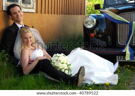 Wetting couple sitting by a cab - stock photo