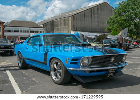 WEYBRIDGE, SURRY, UK - AUGUST 18:  Classic Blue Mustang Boss 302 on show at the annual Brooklands Motor Museums Mustang and Anything American Day in August 2013. - stock photo