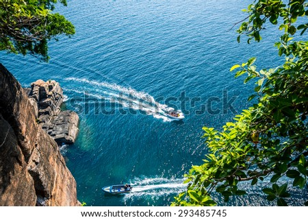 Whale and dolphin watching boats in the beautiful ocean  - stock photo