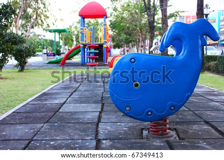 Whale spring toy in kids playground - stock photo
